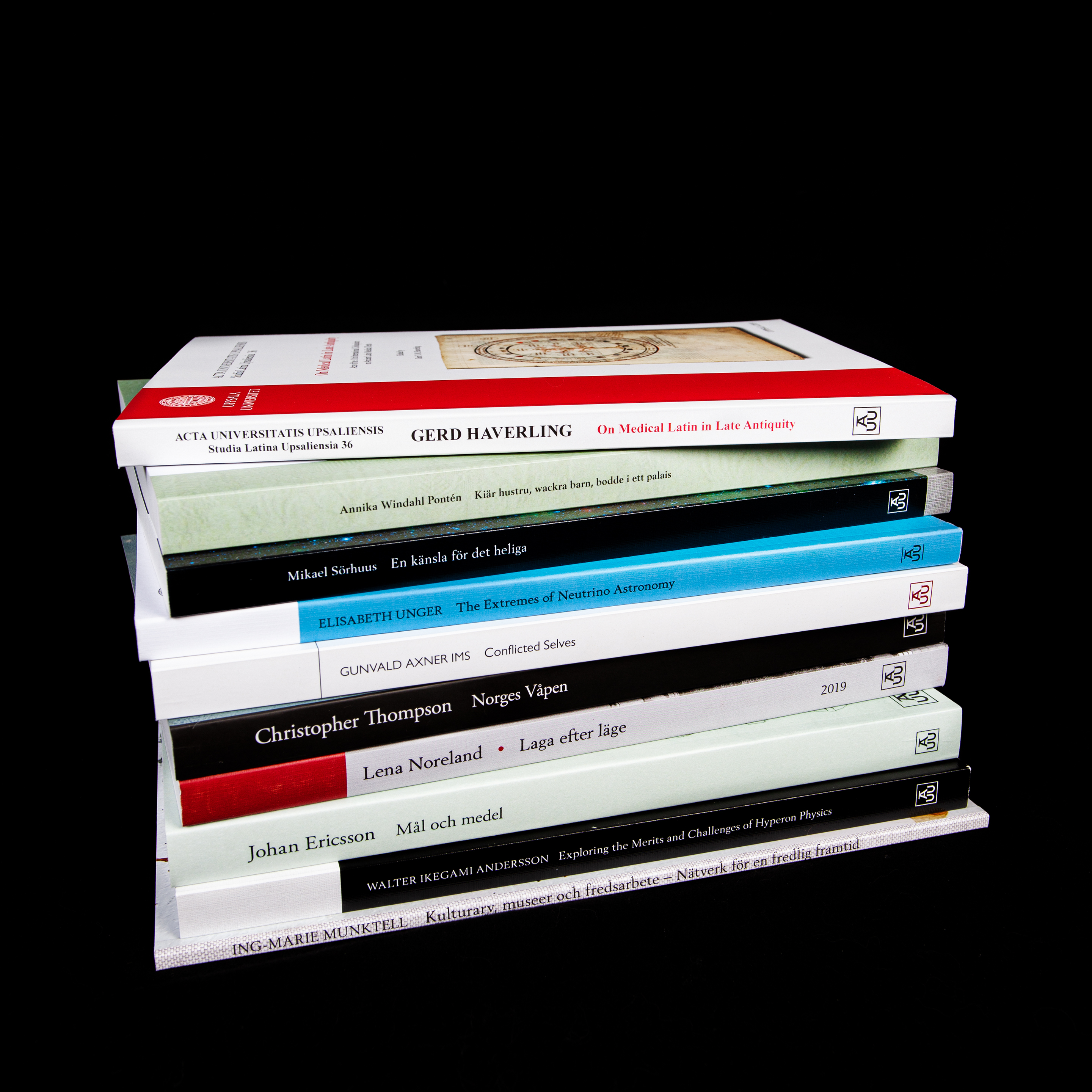 A pile of modern books with soft covers